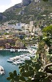 stock photo of lps  - Fontvieille harbour with modern building architecture and luxury yachts on a background Seashore Alps - JPG