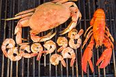 Barbecuing Red Lobster, Crab And Jumbo Shrimps