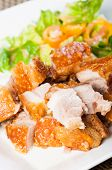 foto of pork belly  - crispy fried pork belly and oriental salad on a side - JPG