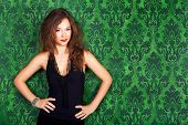 Brunette Model Posing Against A Green Vintage Wall Smiling Fashion Glamour Style