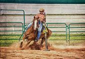 Western horse and rider competing in pole bending and barrel racing competition with texture.