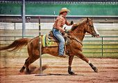 foto of barrel racer  - Western horse and rider competing in pole bending and barrel racing competition with texture - JPG