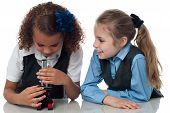 Two Pretty School Girls With Microscope