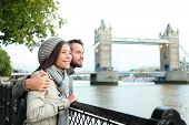 Happy couple by Tower Bridge, River Thames, London. Romantic young couple enjoying view during trave