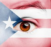 portrait of girl with puerto rican flag painted on her face