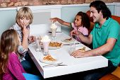 image of eatables  - Family of four having great time in a restaurant - JPG