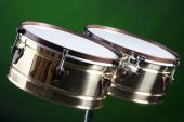 Set Of Brass Timbales Isolated On Green
