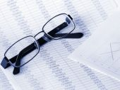 Glasses On Financial Figures.