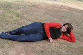 Girl Laying Down In Grass