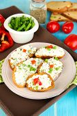 stock photo of hardtack  - Sandwiches with cottage cheese and greens on plate on wooden table close - JPG