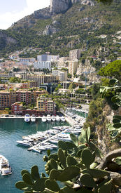 image of lps  - Fontvieille harbour with modern building architecture and luxury yachts on a background Seashore Alps - JPG