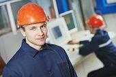 portrait of positive adult industrial worker at factory workshop