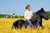 Beautiful Smiling Woman Rides Pretty Horse In Field