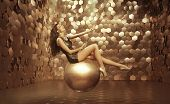 Beautiful woman on a gold ball
