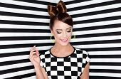 Attractive young woman  on stripy background, beauty and fashion concept