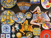 The Trinacria symbol of Sicily and typical Sicilian glazed ceramic