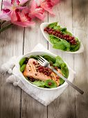 grilled salmon with redcurrants and fresh spinach