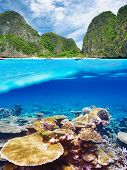 Beautiful lagoon with coral reef bottom underwater and above water split view