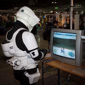 Guy Playing Video Game At Cartoomics 2014 In Milan, Italy