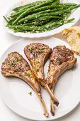 stock photo of red shallot  - Roast Lamb Cutlets with Warm Green Beans  with  Shallots Salad and Roast Tomatoes - JPG