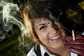 Young Smiling Woman Smokes A Cigarette
