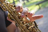 Musician plying Saxophone