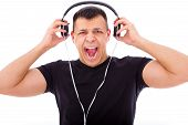 Angry Man Yelling Listening To Loud Music With Headphones