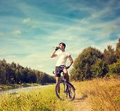 Man Riding a Bicycle on Nature Background