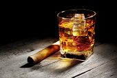 pic of whiskey  - Glass of whiskey with a cigar on wooden table - JPG