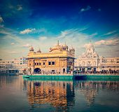 stock photo of gurudwara  - Vintage retro hipster style travel image of famous India attraction Sikh gurdwara Golden Temple  - JPG