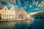 Vintage retro hipster style travel image of Bruges canals. Brugge, Belgium with grunge texture overlaid