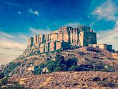 Vintage retro hipster style travel image of Mehrangarh Fort, Jodhpur, Rajasthan, India with grunge texture overlaid