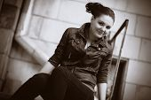 The girl in the urban environment with sepia effect