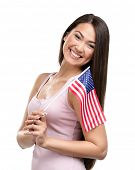 Half-length portrait of female handing American flag, isolated on white