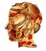 stock photo of unhealthy lifestyle  - Unhealthy diet health concept with a group of greasy fast food in the shape of a human head as a symbol of dangerouse eating lifestyle and icon of addiction to bad nutrition and risk of heart disease - JPG