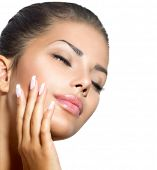 Beauty Spa Woman Portrait. Beautiful Girl Touching her Face.