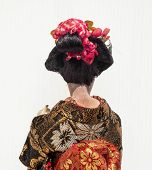 foto of geisha  - Backside of Japanese traditional doll of dancing Geisha with white background - JPG