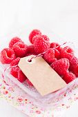 Fresh Raspberries And Cardboard Tag