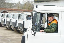 picture of dumper  - industrial dumper truck driver at vehicle automobile company autopark - JPG