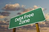 picture of debt free  - Debt Free Zone Green Road Sign In Front of Dramatic Clouds and Sky - JPG