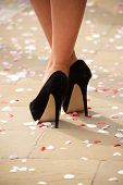 High Heels Crossed At Ankles With Confetti