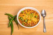 picture of poblano  - A bowl of chili con carne with beans and green chili peppers - JPG