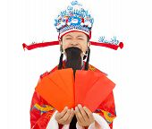 God Of Wealth Holding Red Envelope.isolated On White Background