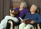 Beautiful elderly couple on sofa