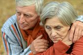 Pensive old couple