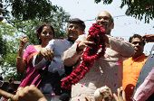 Amit Shah holding a garland.