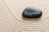 A black stone with the inscription Happiness
