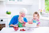 Grandmother Baking Cake With Kids