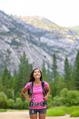 Hiking woman looking up at copy space in Yosemite looking at mountain forest landscape in Yosemite N