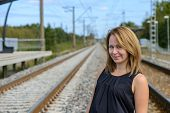 Portrait of girl between two railway path
